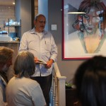 Me saying a few words about Growl standing next to a portrait of Moose in her vegan cafe.